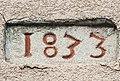 Pierre encastrée dans un mur, datée de 1833, à Cravanche.jpg