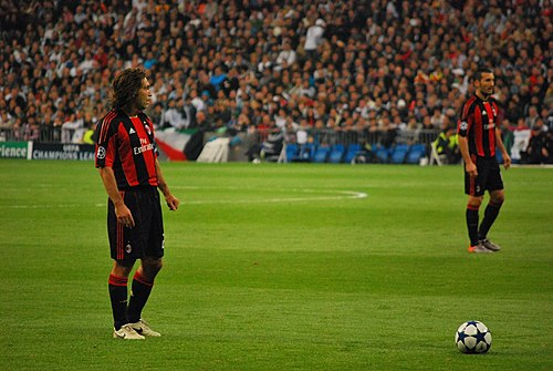 Pirlo (left), with Milan, preparing to take a free kick against Real Madrid in the 2010-11 UEFA Champions League. Pirlo free kick vs Real Madrid.jpg