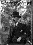 Portrait of a man in a bowler hat (3639537637).jpg