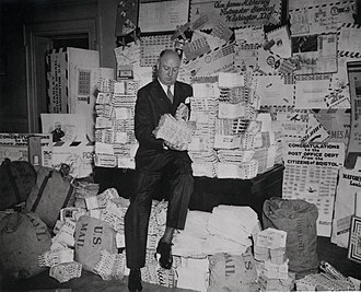 James Farley - Farley sits on a pile of air mail letters in 1938.