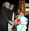 Pratibha Devisingh Patil being welcomed by the Vice President, Mohammad Hamid Ansari and the Prime Minister, Dr. Manmohan Singh on her arrival at Parliament House to address the first day Budget Session of the Parliament.jpg