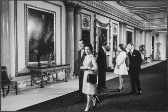 President Nixon with members of the royal family in the ground floor Marble Hall President Nixon visiting Buckingham Palace with Britain's royal family - NARA - 194606.tif