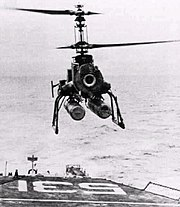 QH-50 DASH drone in flight over USS Hazelwood (DD-531), circa in the early 1960s