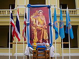 Queen Sirikit's picture with flags.jpg