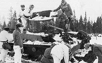Battle of Raate Road - Finnish soldiers inspecting an abandoned Soviet T-26 mod. 1933 at Raate. January 1940.