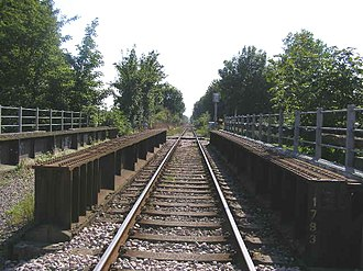 Marshlink line - Most of the Marshlink line is now single track. At the River Tillingham bridge in Rye shown, it is clear where the second track once ran.
