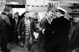 Repatriation - The crew of USS Pueblo as it arrives at the U.N. Advance Camp, Korean Demilitarized Zone, on 23 December 1968, following their release by the North Korean government