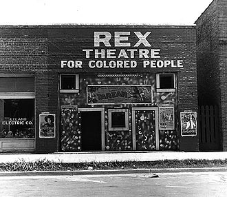 Light in August - Segregated movie theater in Leland, Mississippi in 1937, a result of de jure segregation of black and white people in the South; Joe Christmas lives between the two racially segregated societies.
