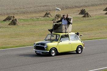 Rowan Atkinson on a Mini at Goodwood Circuit i...