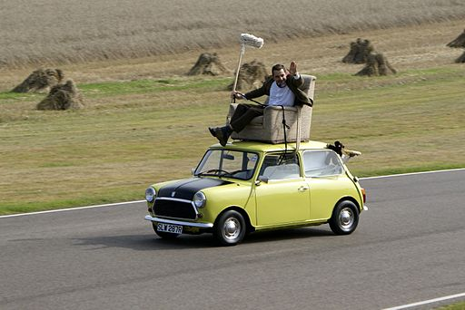 Rowan Atkinson on a Mini at Goodwood Circuit in 2009
