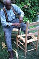 Rufus Adams making a corn shuck chair seat bottom- Mayo, Florida (7507398366).jpg