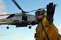 Sailor directs an SH-60F Sea Hawk helicopter (6083532420).jpg