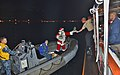 Santa delivers cookies in Pearl Harbor. (8291332890).jpg