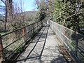 Sarn Lane footbridge crosses the River Alyn at Hope.JPG