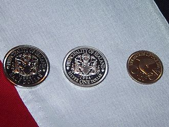 Principality of Sealand - Sealandic coins, from left to right: half dollar, silver one dollar and quarter dollar
