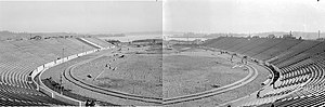 Husky Stadium - Husky Stadium under construction in 1920 in front of Union Bay