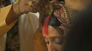Sindoor - The ritual of applying the sindoor as part of a Hindu Indian wedding