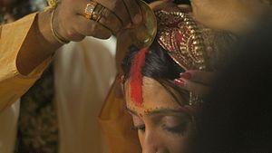 Sindoor - The ritual of applying the sindoor as part of a Hindu Indian wedding