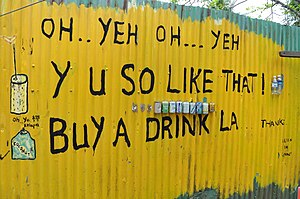Singlish - Lah (La) being used on an advertising board outside a cafe in Pulau Ubin