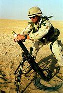 Soldier firing M224 60mm mortar