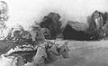 Soviet T-34 with desant rushing into village.jpg