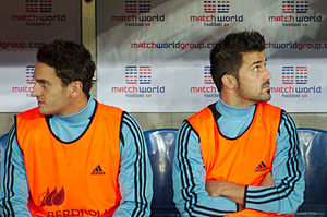 Koke (footballer, born 1992) - Koke (left) on the bench with Atlético teammate David Villa, in a friendly with Chile in 2013