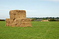 Stack of bales with Napton in the distance - geograph.org.uk - 1498931.jpg