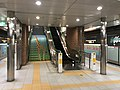 Stairs and escalator on platform of Yakuin-Odori Station.jpg