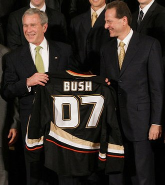 Henry Samueli - Samueli (right) and the Stanley Cup champion Anaheim Ducks present then-President George W. Bush with a jersey