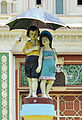 Statue of children with umbrella outside Jaganmohan Palace (crop).jpg