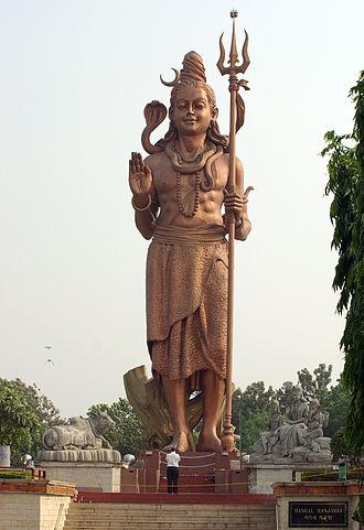 Trishula - Statue of Shiva holding a trishula in Sanga, Nepal