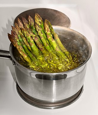 Boiling - A cooking pot with asparagus in boiling water