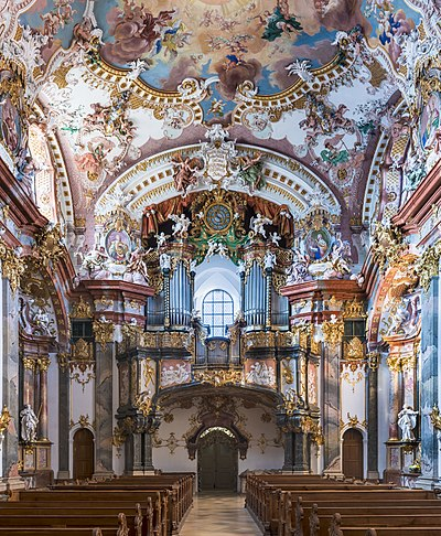 The amazing Rococo interior of the Wilhering Abbey (Wilhering, Austria). This interior has a trompe-l'oeil on its ceiling, surrounded of highly decorated stuccos Stift Wilhering Kirche Orgel 01.jpg