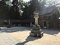 Stone lantern in front of Haiden of Oyamazumi Shrine.jpg