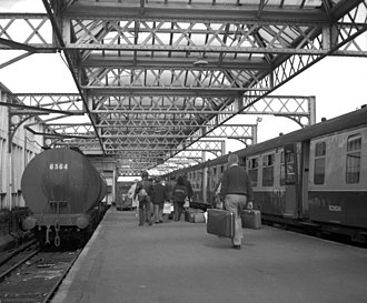 Stranraer railway station - Passengers have just arrived on the train and transfer to the ferry in 1974