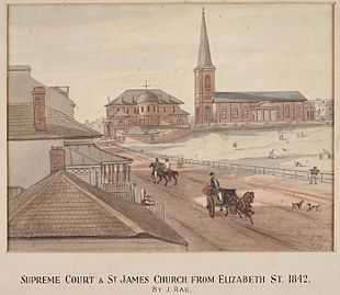 Watercolour of St James' next to the Supreme court. The view is looking north along an unpaved road (now Elizabeth Street) on which there are people walking, riding horses and driving carriages. An empty space (now Hyde Park) appears on the right hand side.