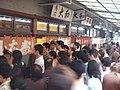 Sushi restaurant by raisin bun in the Tsukiji fish market, Tokyo.jpg