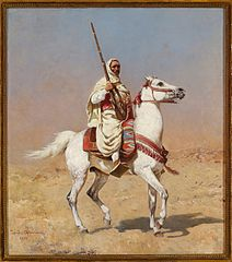 Arab on a gray horse