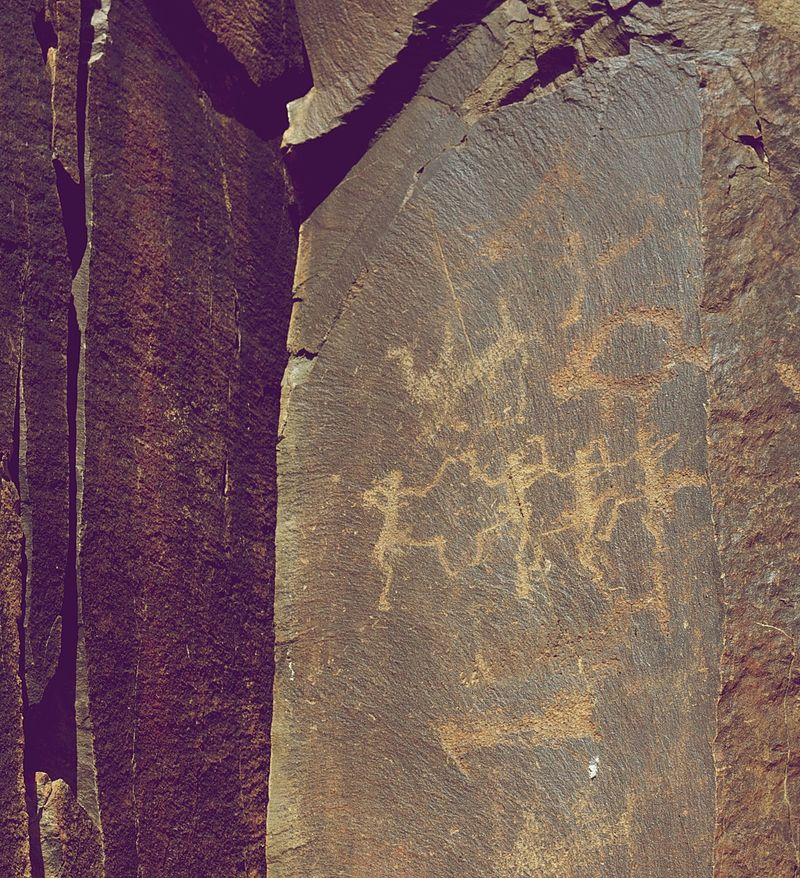 Tamgaly Petroglyphs Dancing People and Camels.jpg