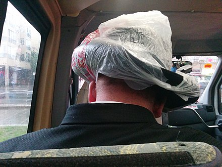 Improvised hat cover of an Orthodox Jew on a rainy day in Tel Aviv. TelAvivRainShelter.jpg
