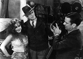 Merritt B. Gerstad - Lili Damita, Charles Brabin, and Merritt B. Gerstad on the set of The Bridge of San Luis Rey (1929)