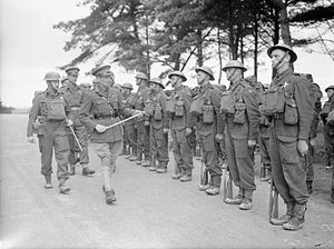 Gerald Templer - Lieutenant General Bernard Montgomery inspecting men of the 7th Battalion, Suffolk Regiment, at Sandbanks near Poole, 22 March 1941. Also pictured, to his right wearing a peaked cap, is Brigadier Gerald Templer.