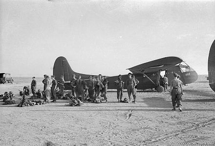 British airborne troops wait to board an American WACO CG4A glider. The Campaign in Sicily 1943 CNA1002.jpg