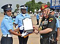 The Chief of Army Staff, General Bipin Rawat presenting the President's Plaque to the Flying Officer Laasya Vadana who stood first in Ground Duty branch, at the Combined Graduation Parade at Air Force Academy, Dundigal.jpg