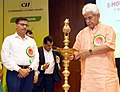 "The Minister of State for Communications (IC) and Railways, Shri Manoj Sinha lighting the lamp to inaugurate the Conference on ""E-Mobility in Indian Railways"", organised by the Indian Railways and NITI Aayog, in New Delhi.JPG"