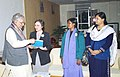 The Union Minister for Human Resource Development Dr. Murli Manohar Joshi is presented UNDP Report by UNICEF Representative in India Ms. Maria Calvis in New Delhi on December 11, 2003.jpg