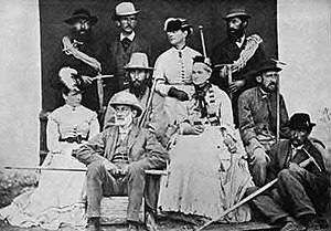 Jakob Anderegg - Jakob Anderegg (standing, top left), with the members of the Walker family, A. W. Moore, and his cousin Melchior Anderegg (standing, top right) 1870