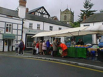Church Stretton - Market on High Street, which has been held in the town since 1214; in the background is the tower of St Laurence's Church