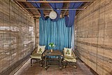 Tiny lobby with bamboo table and armchairs in Heuan Chan heritage house Luang Prabang Laos.jpg