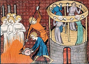 Violence against women - Burning witches, with others held in Stocks